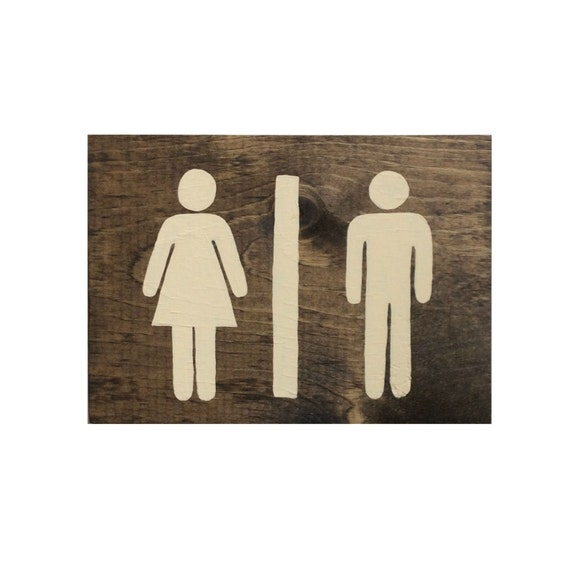 Bathroom restroom signage on wood panel with by