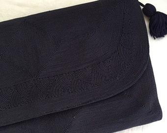 Beautiful navy Corde clutch bag with tassle