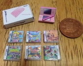 Dolls house handmade miniature nintendo ds bundle (girls)  pink ds console console box and 6 tiny ds games 112 scale