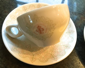Pair of Schonwald Germany demitasse cups and saucers