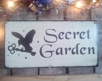 "Primitve Wooden ""Secret Garden"" Bird with key sign"