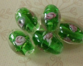 A pack of 5 lampwork glass beads, green barrel
