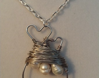 Silver dual hearts and pearl pendant