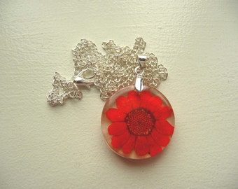 Resin pendant with dried red flower