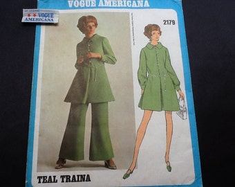 Vogue Americana pattern 2179. Vintage 1960s Teal Traina misses' loose-fitting A-line dress with button loop closing and flared pants.