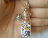 "Sprinkle necklace, Mini glass vial and cupcake candy sprinkles pendant, nonpareils in glass bottle, silver cupcake charm on 24"" chain"