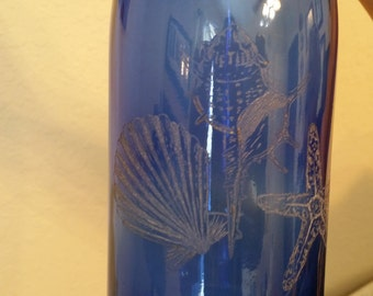 Sea life etched bottle