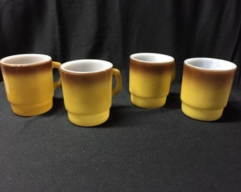 Set of four vintage yellow and brown Fire King mugs