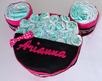 Diaper cake in the shape of Minnie, a personalized gift idea birth