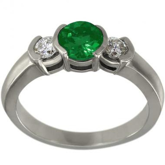 emerald engagement ring with bezel set emerald and diamonds in