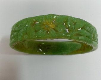 Vintage green plastic bangle bracelet, detailed floral design