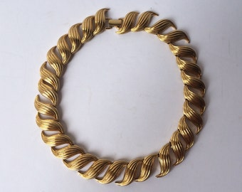 Napier gold interlocking swirl choker