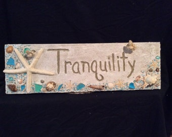Sign made of wood with shells, seaglass, starfish and beads