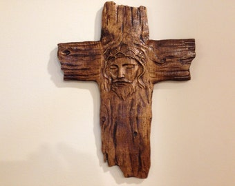Wooden Carved Cross Bares The Image Of Jesus Christ