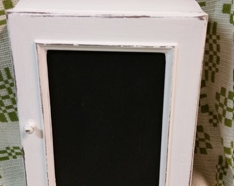 Distressed white cabinet