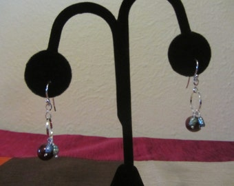 No. 130 Silver hoop earrings with red, green, and blue pearls