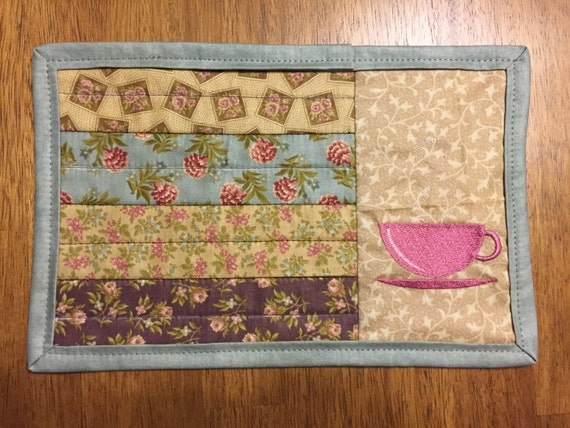 machine embroidered mug rugs