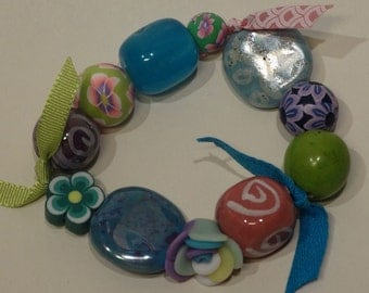 Bracelet with purple, pink, green, blue and white
