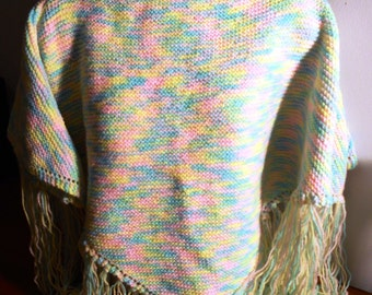 Beat the cold weather! Medium hand knitted poncho style shawl  for you or your family. Ideal  for watching the tv on a cold winters nights