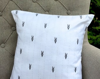 White Monochrome Cushion with chevrons and silver line pattern
