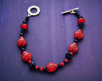 lady bug and rose braclet