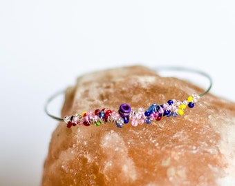 Multi-Colored Glass Beads on Recycled Guitar String, Bangle Bracelet, Recycled guitar string