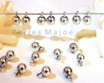 Lot de 10 breloques rondes bombées couleur argent dimensions 4 x 6 mm