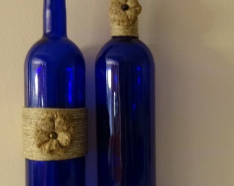 Pair of twine wrapped cobalt blue wine bottles