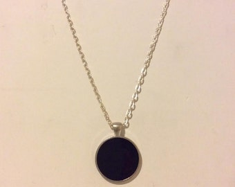 Black and silver resin round pendant necklace