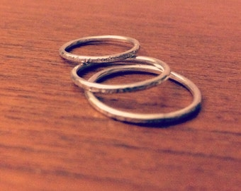 Hammered silver band rings