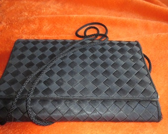 a black patterned shoulder strap bag new