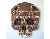Early Man Steampunk Skull Wall Sculpture