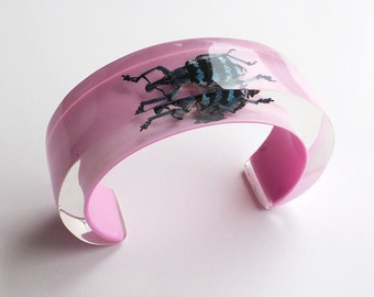 Pink lucite cuff bracelet with real beetle