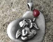 Cupid pendant - fine silver, ruby