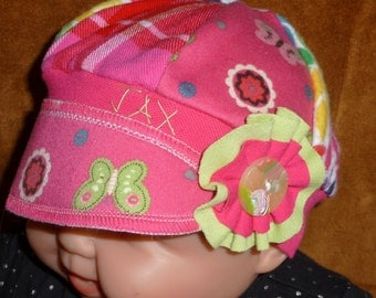 Jax Hat in a rainbow of prints and colors plus butterflies with hot pink and green for infant 0-6 months