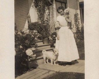 vintage photo Young Lady on Front Yard Holds Bichon Poodle Wire Terrier beside Her RPPC