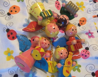 five very cute wooden angel ornaments