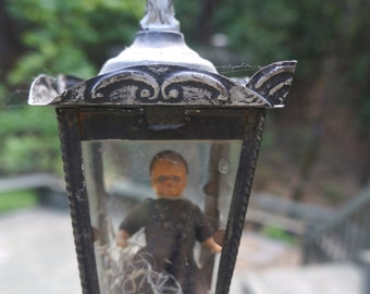 Charming monk in partial vintage light fixture