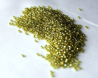 15/0 Tr Golden Olive Luster ( Like DB 124), Miyuki seed beads, 10 gram bag, color #15-1889