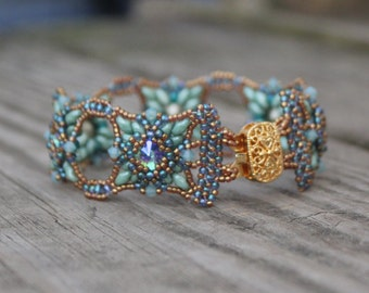 Hand Beaded Bracelet, with Swarovski Rivolis, Crystals and seed beads with Gold plated brass clasp