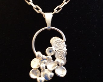 silver free form pendant with clear cz