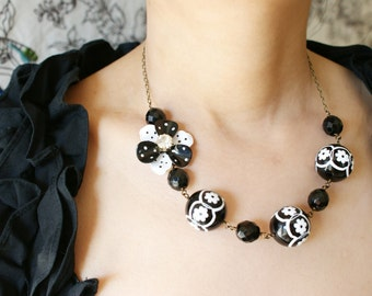 Vintage Black and White Necklace, Black White Polka Dot flower brooch, vintage Lucite Scandinavian folktale floral motif