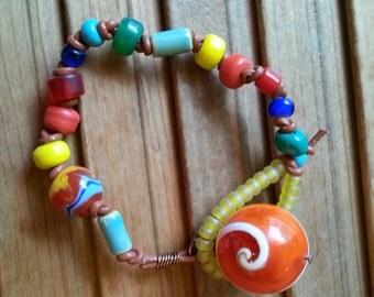 Planet Rainbow and Sunshine Beaded Bracelet on leather cording