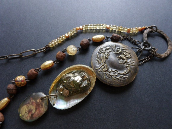 Philocaly. Golden lariat with pyrite and antique compact mirror. Victorian tribal assemblage.