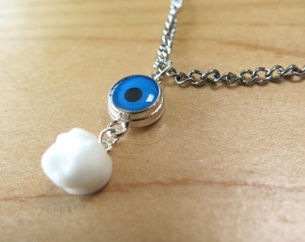 Tooth and Eye Necklace