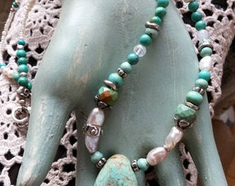 turquoise stone dangles from gemstones, freshwater pearls and bits of silver for a cool summery necklace