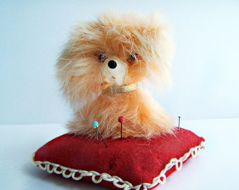 Vintage Mink Pink Poodle Pin Cushion Fluffy Pampered Poodle Dog Sits on a red pillow pincushion , glass eyes 1950s Sewing Collectible