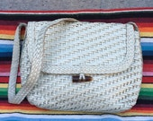 80s White leather, basket weave, woven, rattan-like shoulder bag, cross body purse, with faux bone / antler hardware