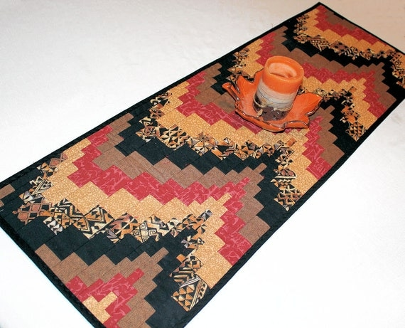 Bargello southwest quilted table runner in rust black gold and tan