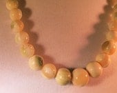 A Glass Bead Vintage Necklace in Shades of Pale Creams and Greens